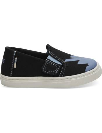 c550ccfc7049 Black Canvas Glow In The Dark Tiny TOMS Luca Slip-Ons Shoes from Toms Uk
