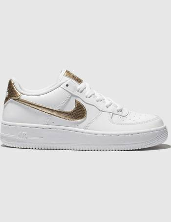 a2e75c2789 Nike. White & Gold Air Force 1 Ep Trainers Youth. from Schuh