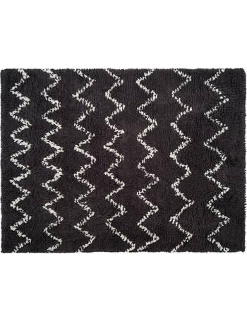 FLOKATI Extra small cream hand woven wool rug 80 x 130cm