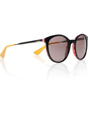 ea90f1157d114 Shop Women s Prada Round Sunglasses up to 40% Off