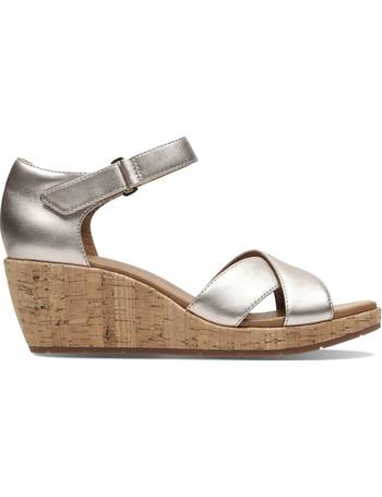 5e74a128de7f6 Clarks. Un Plaza Cross Leather Wedge Sandals. from La Redoute