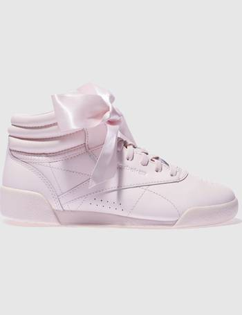 55eac96908e Reebok. pale pink freestyle hi bow Girls Junior Trainers
