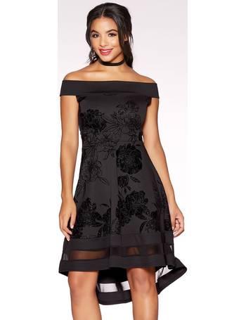 ad03a4d025a Black Glitter Flock Floral Print Bardot Dip Hem Dress from Quiz Clothing