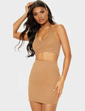 04a1bf3e4b7 Camel Bandage Rib Halterneck Cross Front Crop Top from Pretty Little Thing