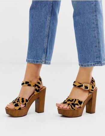 669500ec5f6 Hawaiian leopard pony wooden platform heeled sandals