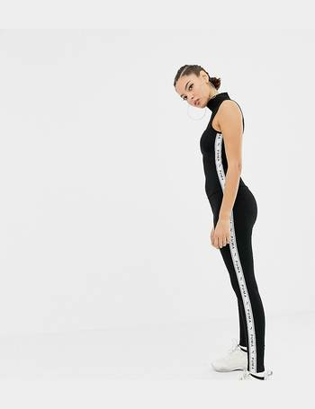 f573a04b8164 Puma. exclusive black tapping high neck jumpsuit. from ASOS