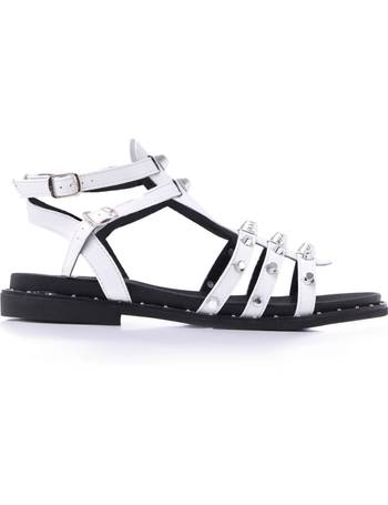 bf44ea48b11 Heavy Studded White Ankle Strap Flat Sandals from KOI Footwear