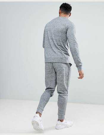 2dad0810 ASOS DESIGN. tracksuit sweatshirt/ tapered joggers in grey and navy interest  fabric