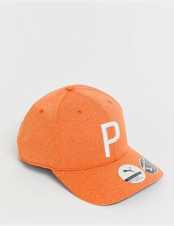 ed51d28f Puma. Golf snapback cap in orange 02144805. from ASOS