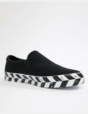 c2f9332752b6 slip on plimsolls in black canvas with diagonal checkerboard sole from ASOS