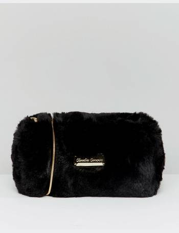 0d663cff48bb soft faux fur cross body bag with zip top opening and metal detail from ASOS