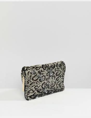 e58588c4269 Aldo. Conga sequin leopard print foldover clutch bag
