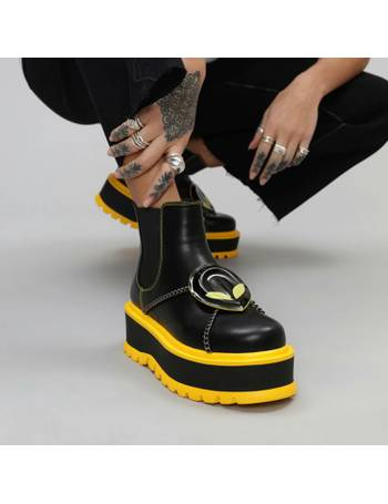 676de9a777b Black and Yellow Alien Head Extra Chunky Platform Boots with Chains from KOI  Footwear