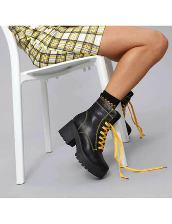 9984e03febd Black Chunky Platform Biker Boots with Yellow laces and Stitching from KOI  Footwear