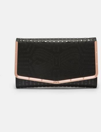 af4364307 Laser cut leather bow clutch bag Black from Ted Baker