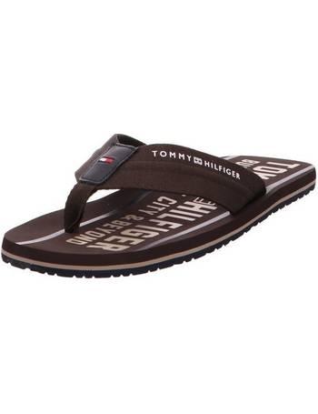 d48085cd12d4 Shop Men s Tommy Hilfiger Flip Flops up to 40% Off