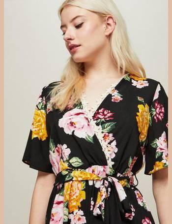 57e287af5d Womens PETITE Black Floral Printed Playsuit from Miss Selfridge