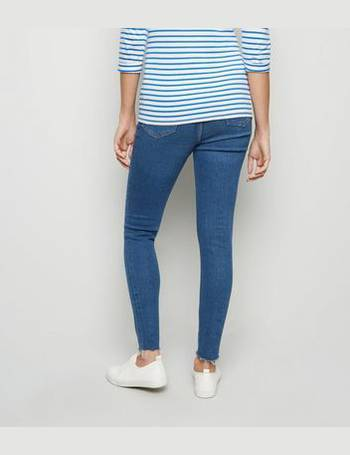 10831c868c4b5 Maternity Blue Ripped Knee Under Bump Skinny Jeans New Look from New Look