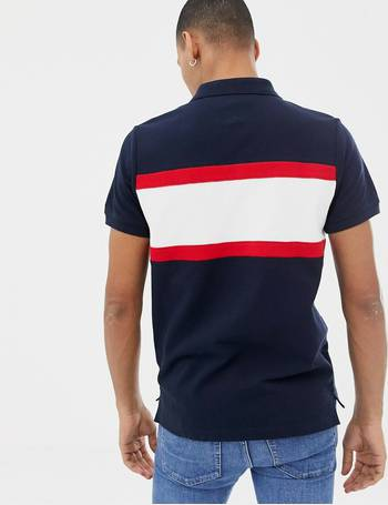 ae9eb93043ec Tommy Hilfiger. icon stripe chest insert pique polo slim fit in navy/multi