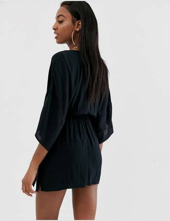 d4221fefd8 ASOS DESIGN Tall plunge tie waist kimono sleeve crinkle beach cover up in  black from ASOS