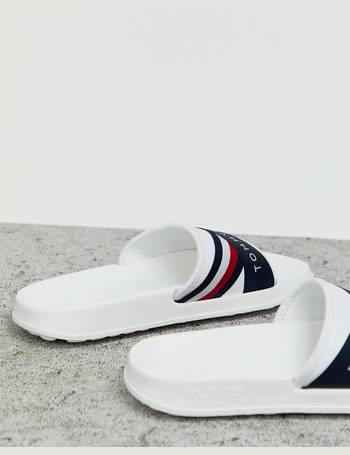 985f70d5e Tommy Hilfiger. Splash slider with crossover logo and icon stripe in white