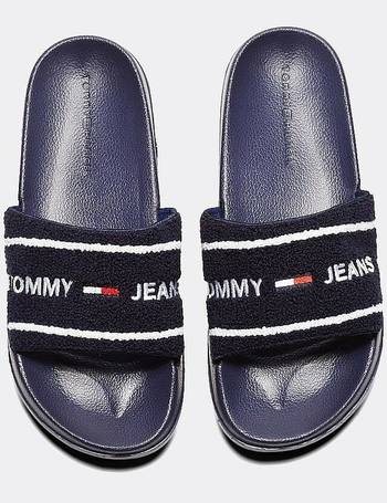 6db0aa7080b Tommy Hilfiger. Pink Tj Flag Pool Slide Sandals. from Schuh. £45.00. Womens  Beach Slide from Footasylum
