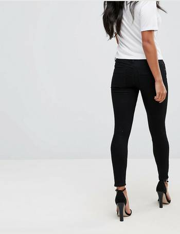 7e30e6dfe ASOS DESIGN Petite Whitby low rise skinny jeans in clean black from ASOS